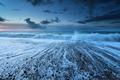ocean waves in dusk with long exposure