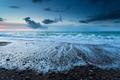 Atlantic ocean beach at dusk
