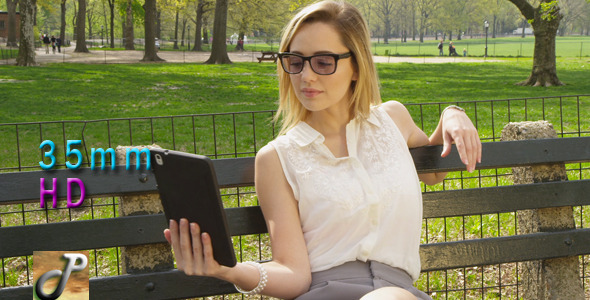 Woman On Tablet With Sunglasses