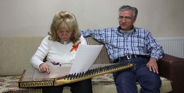 Woman Playing Qanun While Husband Listening