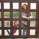 Woman and a small girl behind a wooden gate - PhotoDune Item for Sale