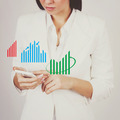 Businesswoman checking charts on smart phone - PhotoDune Item for Sale