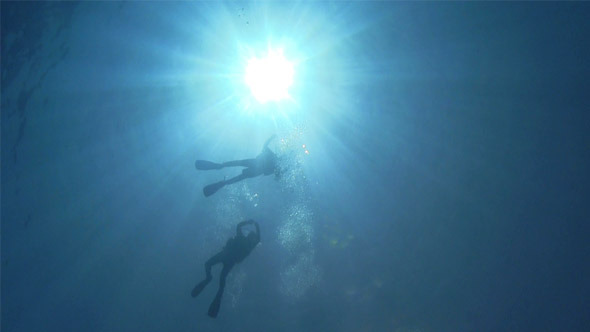 Divers Swims Over Camera 724