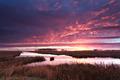 dramatic fire sunrise over river