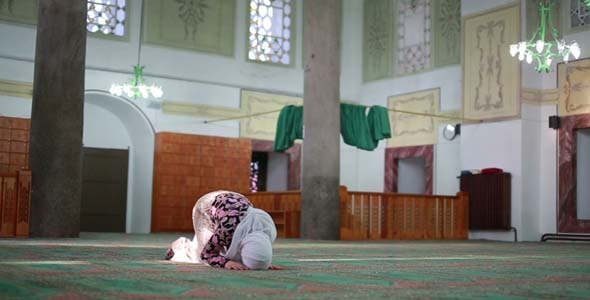 Muslim Girl Saying Salat Prayer In Mosque
