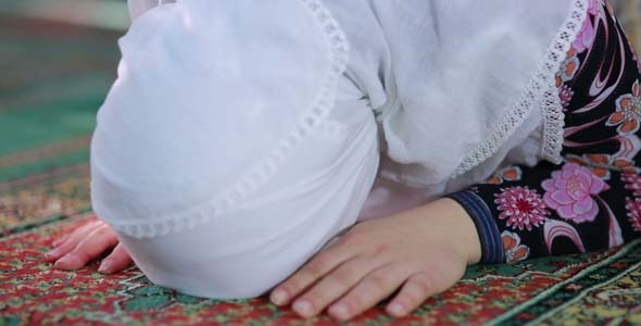 Young Muslim Girl Reading Quran In Mosque