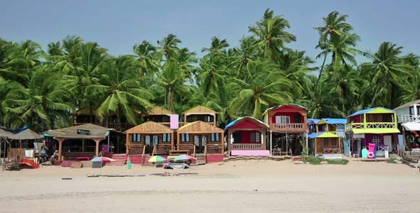 Colourful Bungalows In Resort On Sandy Beach