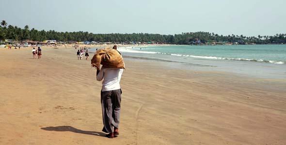 People Walking Along Sandy Beach