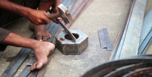 Local Craftsman Working On Piece Of Metal India