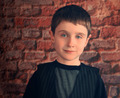 Photo Portrait of Young Boy with Brick Wall - PhotoDune Item for Sale