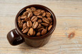 brown cup with coffee beans - PhotoDune Item for Sale