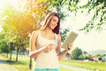 Young woman in park with tablet and takeaway coffee - PhotoDune Item for Sale