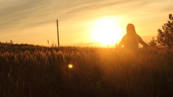 Girl Running In the Sunset