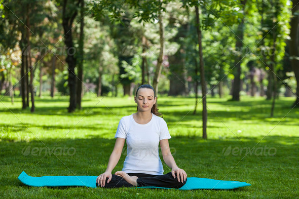Girl Relaxing in a Green Park - Stock Photo - Images