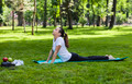 Girl Stretching in a Green Park - PhotoDune Item for Sale