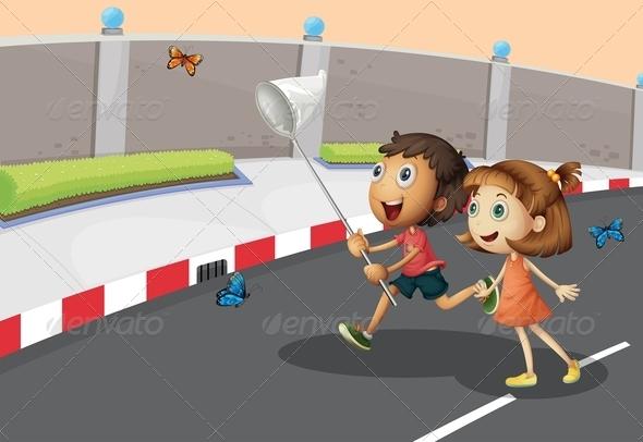 Kids catching butterflies on the street