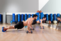 Dumbbells push-ups couple at fitness gym - PhotoDune Item for Sale