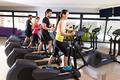 Aerobics elliptical walker trainer group at gym
