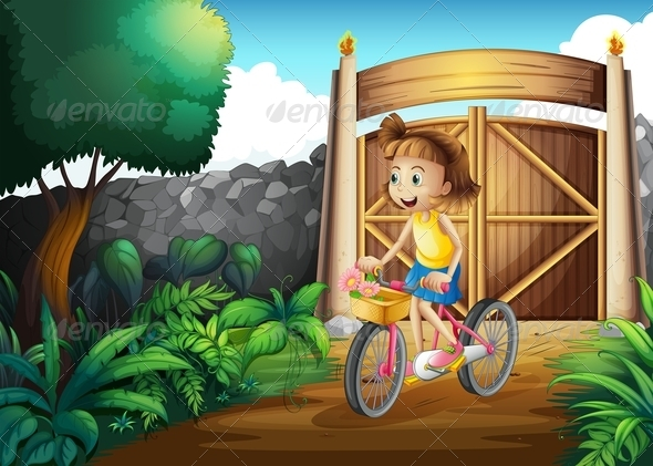 Girl biking in the yard