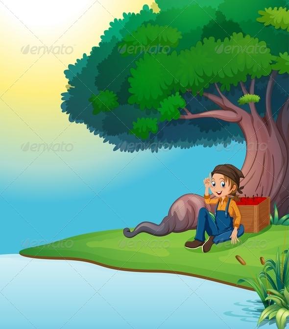 Boy relaxing under tree