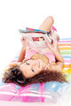 girl reading magazine on air mattress - PhotoDune Item for Sale