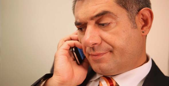 Businessman Using Mobile Phone Smiling