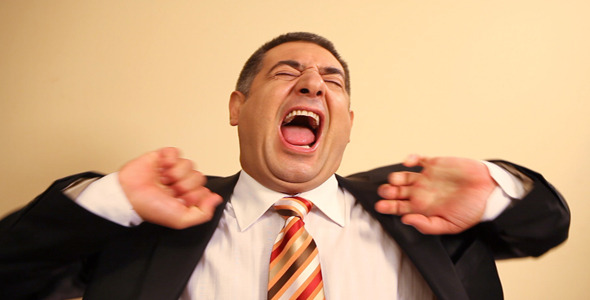 Tired Businessman Yawning And Stretching