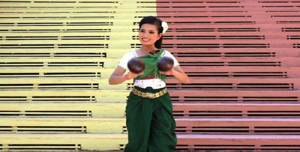 Beautiful Asian Girl Performs Coconut Folk Dance