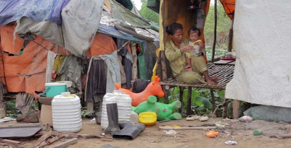 VideoHive Mother Feeding Baby In Cambodian Slums 7873409