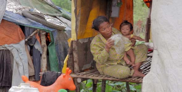 VideoHive Mother Feeding Baby In Cambodian Slums 7873456