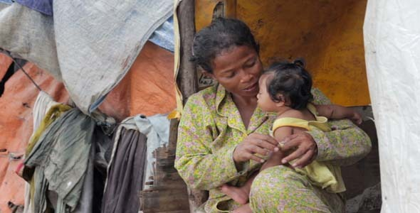 VideoHive Mother Feeding Baby In Cambodian Slums 7873458