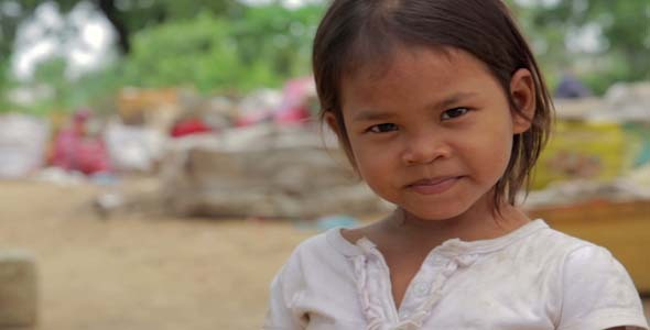 Cambodian Girl In Slums Garbage in Background
