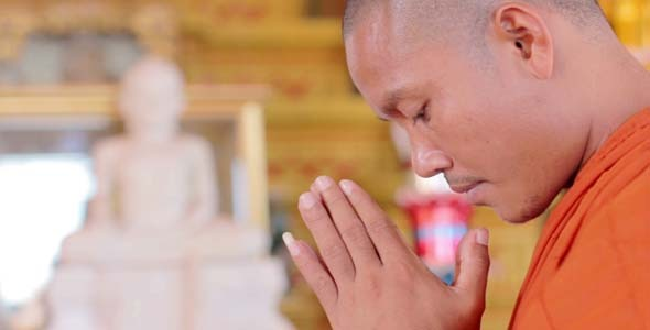 Buddhist Monk With Orange Robe Pray in Temple