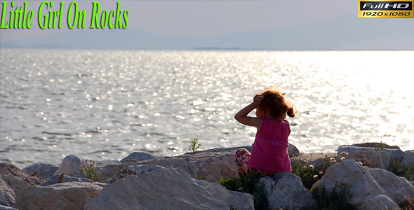 Little Girl On Rocks