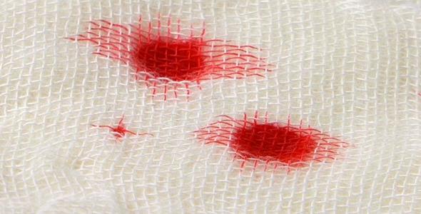 Blood Drops on Gauze Bandage