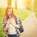 Teenage student girl with smart phone texting - PhotoDune Item for Sale