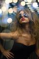 beautiful woman in sunglasses in elevator
