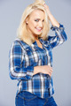 Beautiful happy blond girl in blue jeans - PhotoDune Item for Sale