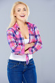 Laughing confident curvaceous blond woman - PhotoDune Item for Sale