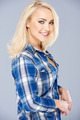 Smiling beautiful blond in a checked blue shirt - PhotoDune Item for Sale