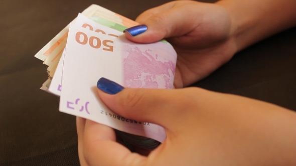 Girl Counting Euro