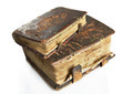 Ancient worn books with leather cover on light background - PhotoDune Item for Sale