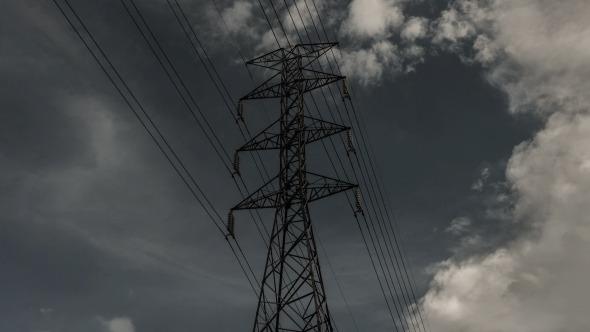 Electricity Pole With Rain Cloud