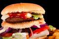 Hamburger with fries isolated on black background - PhotoDune Item for Sale