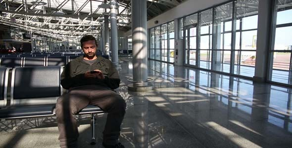 Man Using Mobile Phone At Airport