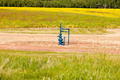 Natural gas wellhead Alberta Canada grassland - PhotoDune Item for Sale