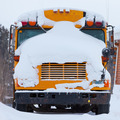 Parked school bus winter blizzard snow cover - PhotoDune Item for Sale
