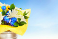 Bouquet of bright flowers in a metal bucket against blue sky - PhotoDune Item for Sale