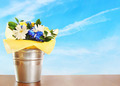 Bouquet of flowers in a bucket against blue sky - PhotoDune Item for Sale