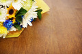Bouquet of flowers lying on a wooden surface - PhotoDune Item for Sale